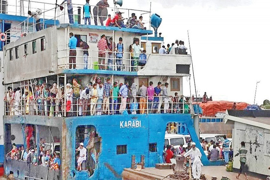A large number of people, heading for Dhaka to resume their duties, seen on board a ferry at Mawa Ghat on Saturday — Focus Bangla