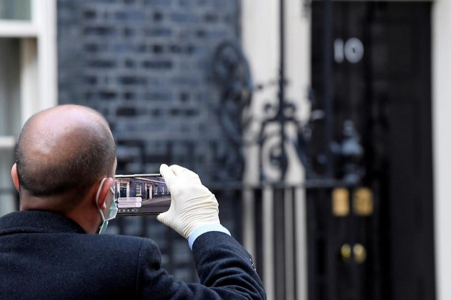 A journalist is pictured filming the front of 10 Downing street after Britain's prime minister Boris Johnson tested positive for the coronavirus disease (COVID-19), in London, Britain, March 27, 2020. — Reuters/Files