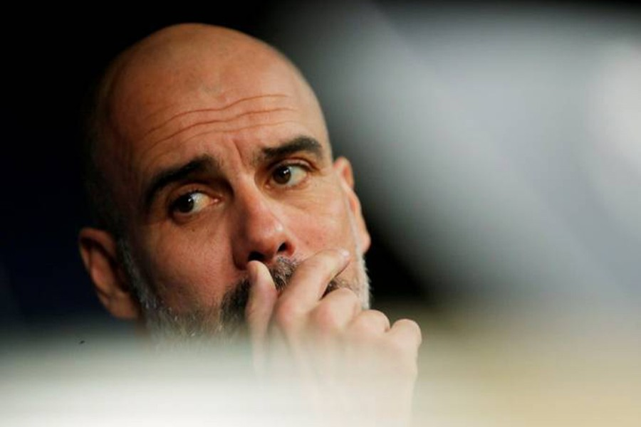 A dejected Pep Guardiola is seen in this undated Reuters photo