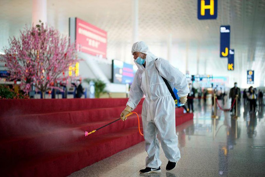 A worker in protective suit disinfects the Wuhan Tianhe International Airport after travel restrictions to leave Wuhan, the capital of Hubei province and China's epicentre of the novel coronavirus disease (COVID-19) outbreak, were lifted on April 8, 2020 — REUTERS photo