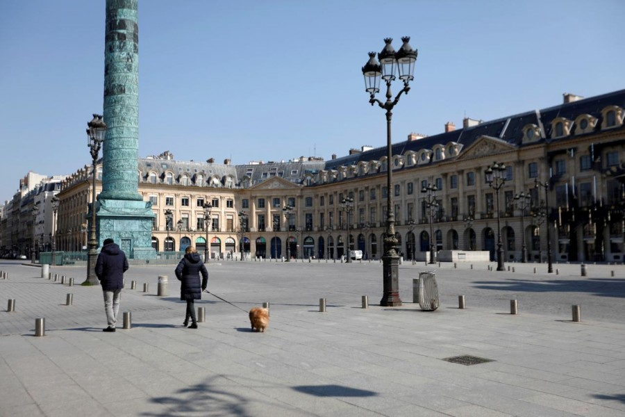 World News March 27, 2020 / 10:23 PM / 12 days ago France extends coronavirus lockdown by two weeks to April 15  1 Min Read  Local residents walk on the deserted Place Vendome in Paris as a lockdown is imposed to slow the rate of the coronavirus disease (COVID-19) in France, March 27, 2020. REUTERS/Charles Platiau