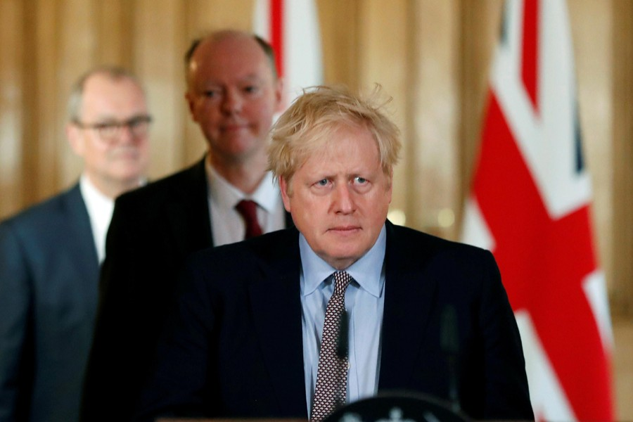 Britain's Prime Minister Boris Johnson, Chris Whitty, Chief Medical Officer for England and Chief Scientific Adviser to the Government, Sir Patrick Vallance, arrive for a news conference on the novel coronavirus, in London, Britain on March 3, 2020 — Reuters/Files