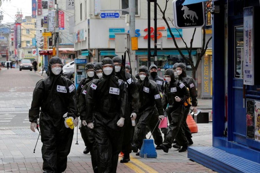 South Korean soldiers in protective gear make their way while they disinfect buildings downtown, following the rise in confirmed cases of coronavirus disease (COVID-19) in Daegu, South Korea on March 15, 2020 — Reuters/Files