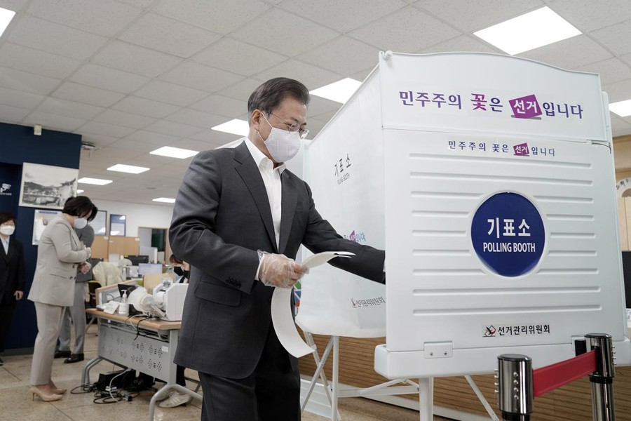 South Korean President Moon Jae-in wearing a mask and a plastic gloves to prevent contracting the coronavirus disease (COVID-19), arrives to cast his absentee ballot at a polling station for parliamentary election in Seoul, South Korea on April 10, 2020  — Yonhap via REUTERS
