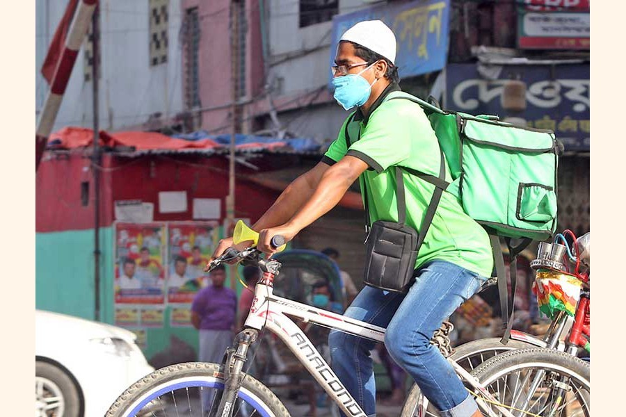 A file photo shows a biker delivering food in the city recently--FE photo