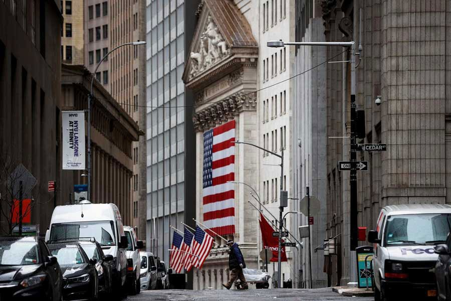 A man crosses a nearly deserted Nassau Street in front of the New York Stock Exchange (NYSE) in the financial district of lower Manhattan during the outbreak of the coronavirus disease (Covid-19) in New York City, New York, US on April 03, 2020. -—Photo: Reuters