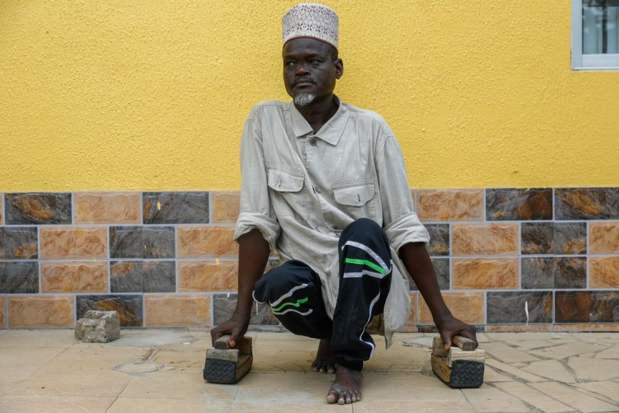 FILE PHOTO: Shehu Isah Daiyanu Dumus, 53, poses for a photo near his home in Lagos, Nigeria April 6, 2020. Picture taken April 6, 2020. REUTERS/Temilade Adelaja