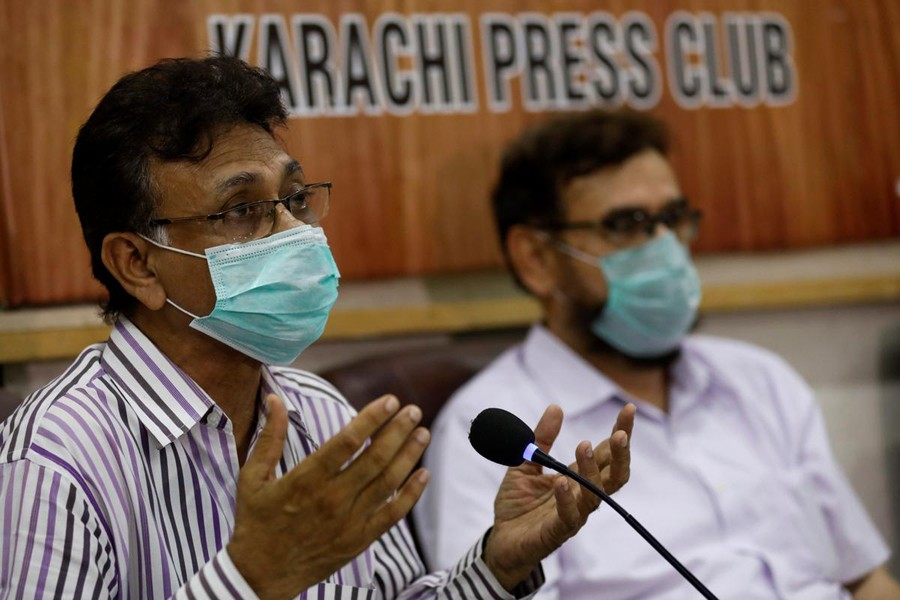Dr Qaiser Sajjad, secretary-general of the Pakistan Medical Association (PMA) along with other doctors speaks during a news conference to appeal government and religious scholars for a strict implementation of the lockdown to prevent congregations in Ramadan, to stem the spread of the coronavirus disease (COVID-19), in Karachi, Pakistan on April 22, 2020 — Reuters photo