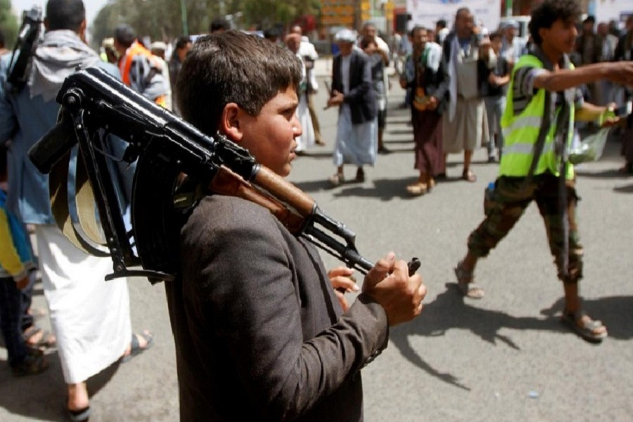 A boy carries a weapon as he and Houthi supporters are seen during a gathering in Sanaa, Yemen, April 02, 2020. — Reuters/Files