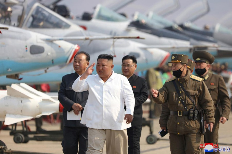 North Korean leader Kim Jong Un visits a pursuit assault plane group under the Air and Anti-Aircraft Division in the western area in this undated image released by North Korea's Korean Central News Agency (KCNA) in Pyongyang on April 12, 2020 — KCNA/via REUTERS