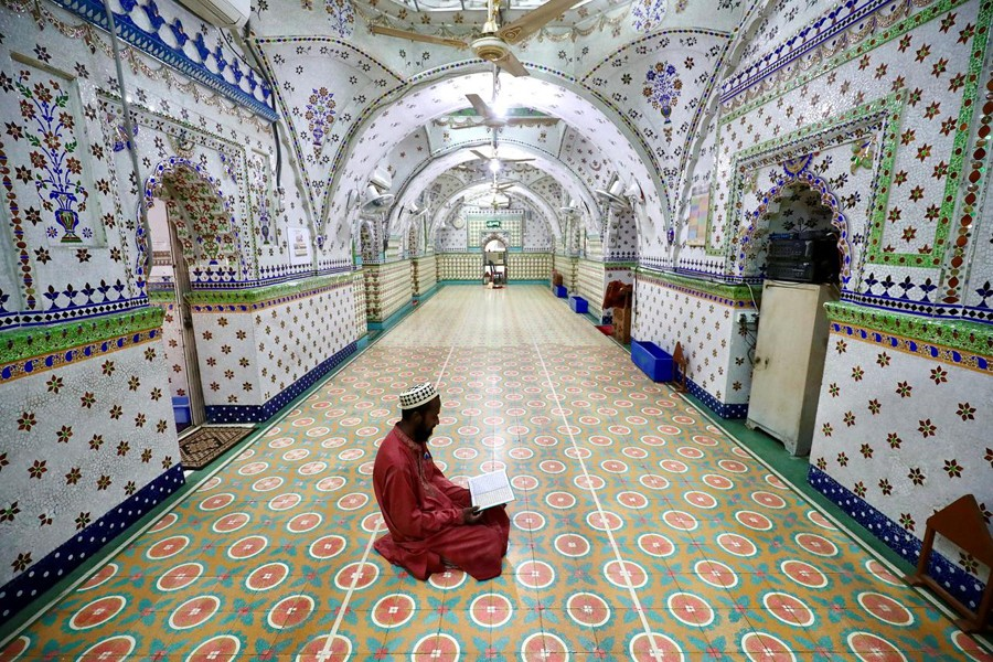 A Muslim devotee recites the Qur'an at the Star Mosque during Ramadan in Dhaka, Bangladesh on April 26, 2020 — Reuters photo