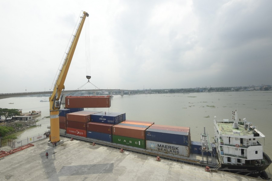In an attempt to decongest Chattogram Port an inland container vessel is seen discharging a full load of containers, originally bound for Kamalapur ICD, at SAPL's Container Terminal located at Munshiganj.