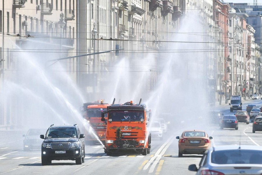 Vehicles spray disinfectant while sanitizing a road amid the outbreak of the coronavirus disease (COVID-19) in Moscow, Russia May 1, 2020. Sergei Kiselyov/Moscow News Agency/Handout via REUTERS