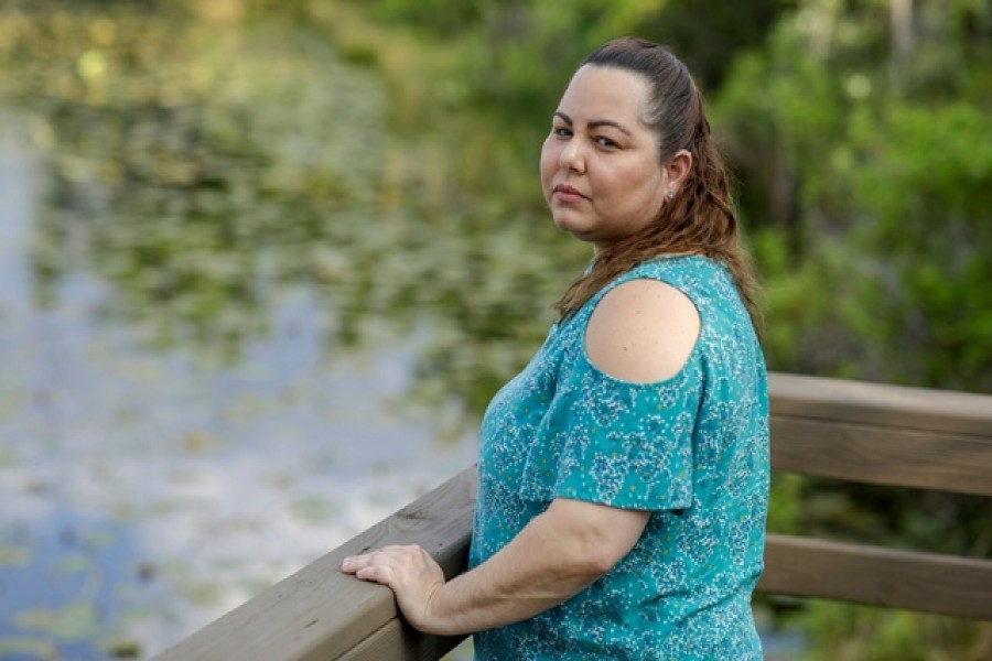 Claudia Alejandra, 37, furloughed from her job at the makeup counter at Macy's amid the coronavirus disease (COVID-19), poses for a portrait near a lake in Orlando, Florida, US, March 06, 2020. – Reuters/Files
