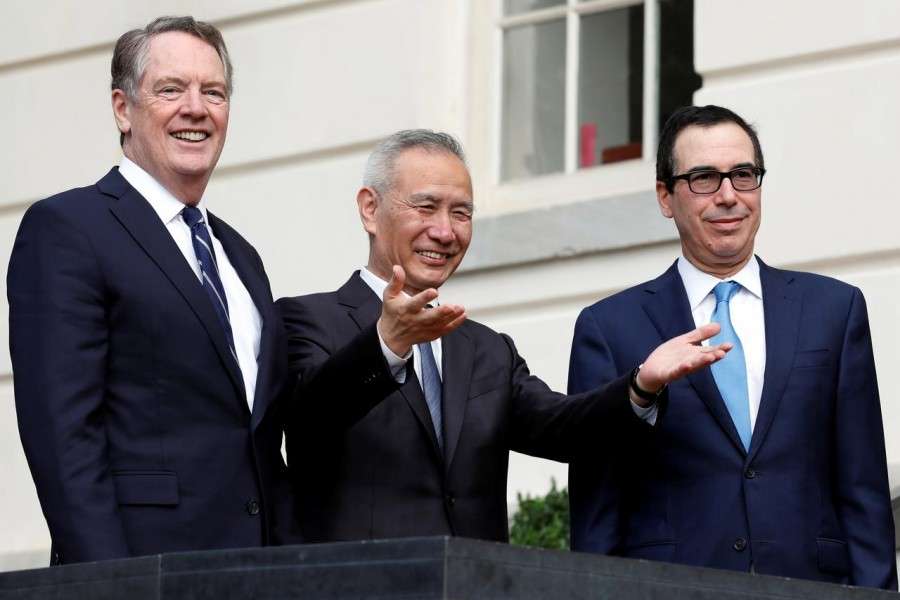 China's Vice Premier Liu He gestures to the media between US Trade Representative Robert Lighthizer (L) and Treasury Secretary Steve Mnuchin before the two countries' trade negotiations in Washington, US on October 10, 2019 — Reuters/Files