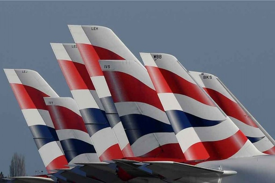 Tail Fins of British Airways planes are seen parked at the Heathrow airport as the spread of the coronavirus disease continues on Mar 31. REUTERS