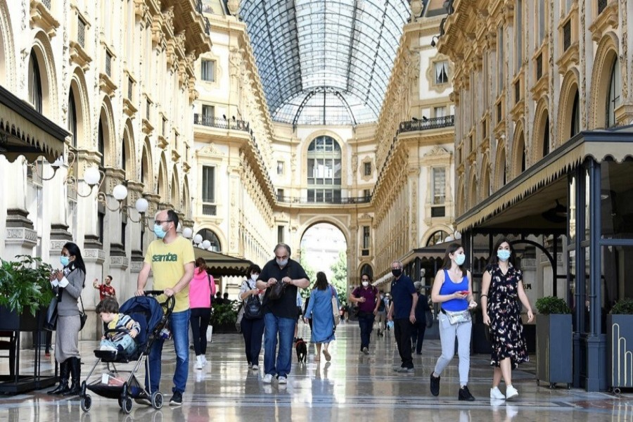 People walk at Galleria Vittorio Emanuele II, as Italy eases some of the lockdown measures put in place during the coronavirus disease (COVID-19) outbreak, in Milan, Italy, May 18, 2020. — Reuters