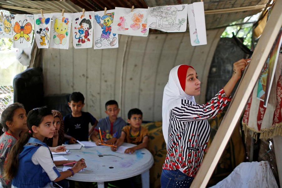 A Palestinian school girl Fajr Hmaid, 13, teaches her neighbours' children an Arabic language lesson as schools are shut due to the coronavirus disease (COVID-19) restrictions, at her family house in Gaza on May 19, 2020 — Reuters photo