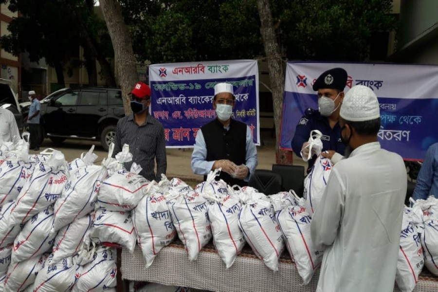 NRB Bank distributes food support to under-privileged people of Gopalgonj