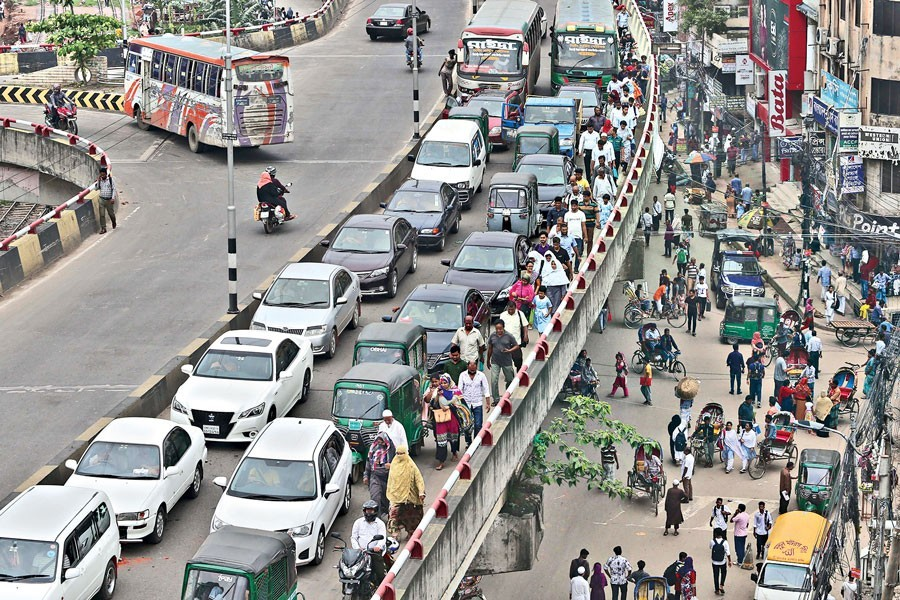 Representational image: In this July 08, 2019, file photo, commuters heading for their respective destinations on foot as vehicles, including private cars, were caught in a severe traffic jam on the Khilgaon flyover in Dhaka city while rickshaw pullers blockade some city points over the ban imposed on the tricycles on three roads — FE Photo