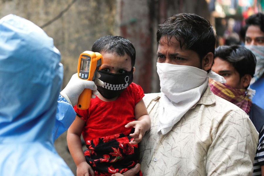 A doctor scans residents from Dharavi, one of Asia's largest slums, with an infrared thermometer to check their temperature as a precautionary measure against the spread of the coronavirus disease (COVID-19), in Mumbai, India on April 11, 2020 — Reuters/Files