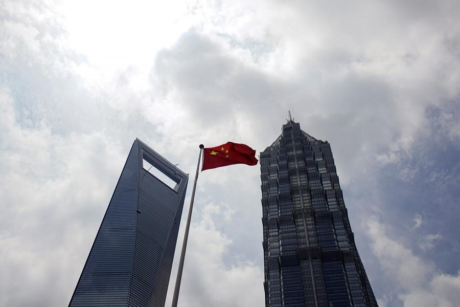 A Chinese flag is pictured at Lujiazui financial district in Pudong, Shanghai, China, May 22, 2020. — Reuters