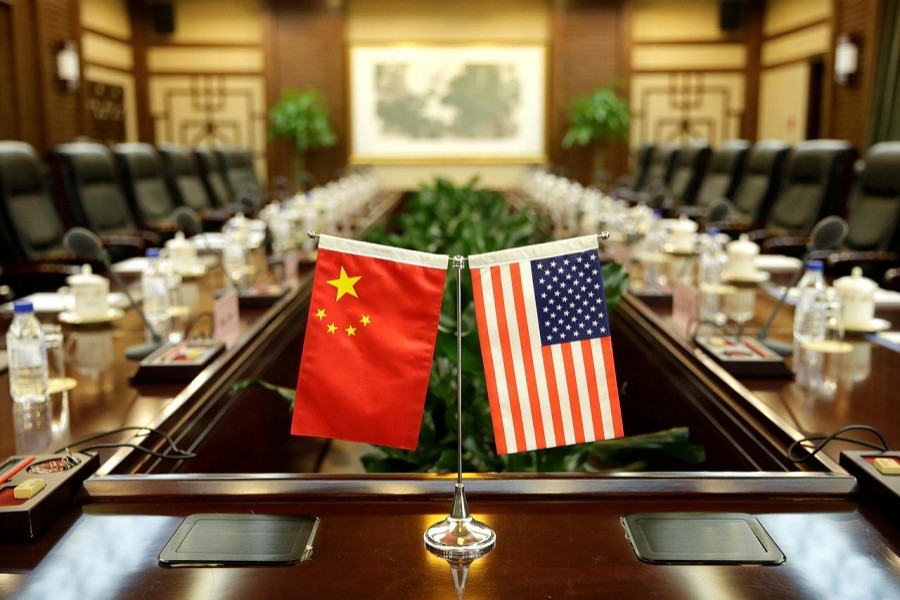 Flags of US and China are placed for a meeting between Secretary of Agriculture Sonny Perdue and China's Minister of Agriculture Han Changfu at the Ministry of Agriculture in Beijing, China, June 30, 2017. — Reuters/Files