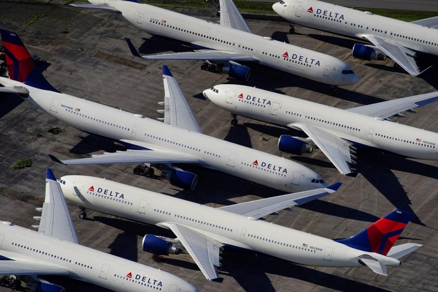 Delta Air Lines passenger planes are seen parked due to flight reductions made to slow the spread of coronavirus disease (COVID-19), at Birmingham-Shuttlesworth International Airport in Birmingham, Alabama, US March 25, 2020. REUTERS/Elijah Nouvelage