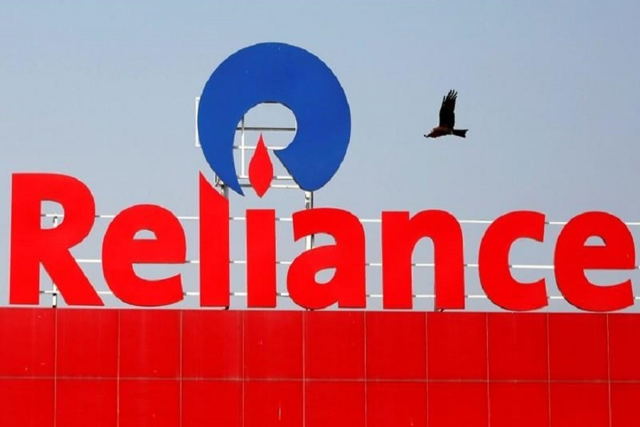 A bird flies past a Reliance Industries logo installed on its mart in Ahmedabad, India, January 16, 2017. — Reuters/Files