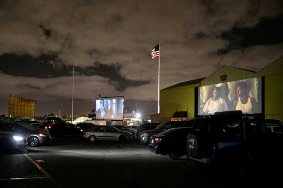 People inside their cars watch a movie at a drive-in theatre while keeping social distancing following the outbreak of the coronavirus disease (COVID-19) in Fort Lauderdale, Florida, US, Mar 28, 2020. REUTERS