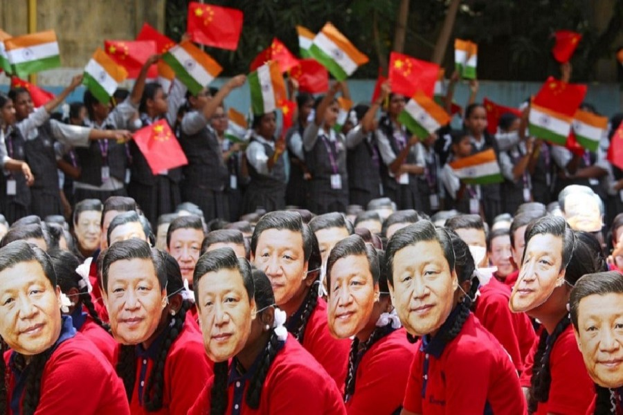 File photo of students wearing masks of China's President Xi Jinping as others wave national flags of India and China, ahead of the informal summit with India's Prime Minister Narendra Modi, at a school in Chennai, India, October 10, 2019. — Reuters