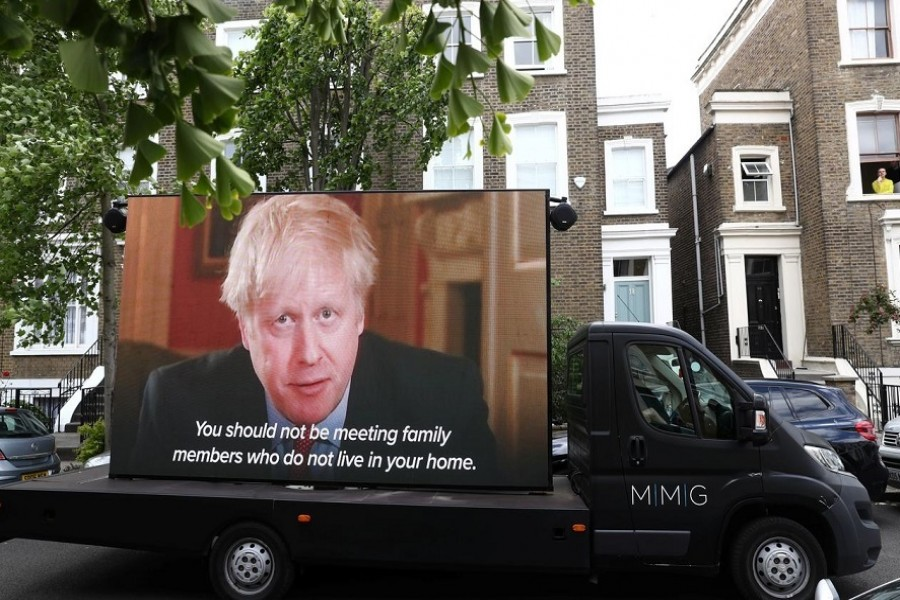 "A ""Led by donkeys"" truck displaying a video of Britain's Prime Minister Boris Johnson, drives by Dominic Cummings' house in London, following the outbreak of the coronavirus disease (COVID-19), London, Britain, May 24, 2020. — Reuters"