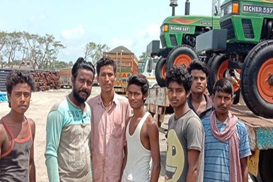 Seven of the 19 Indian truck drivers pose for photograph — FE Photo