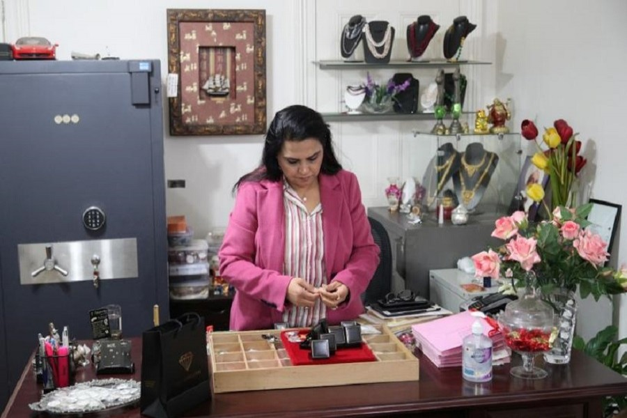 Jewellery designer Jyoti Tuli attends to the shop she runs with her husband, where a business has slowed substantially since the onset of the coronavirus disease (COVID-19) outbreak, in the Parramatta suburb of western Sydney, Australia, May 29, 2020. — Reuters