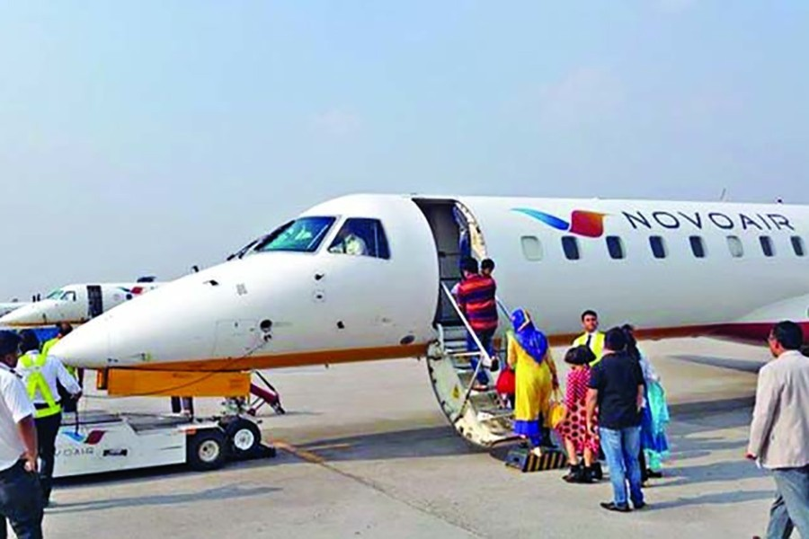Passengers queue for boarding their flight on a Novoair service — File photo used only for representation