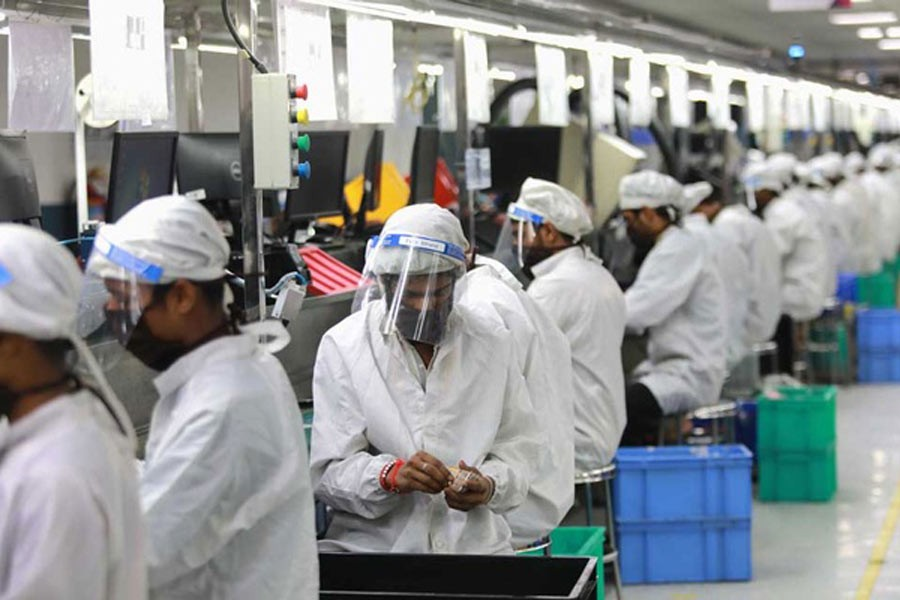 Workers performing duties at an assembly line of mobile phones at Lava International Limited's manufacturing plant, during coronavirus outbreak in Noida of India this months –Reuters Photo