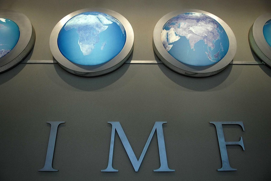 The IMF nameplate is displayed on a wall at the headquarters during the World Bank/International Monetary Fund Spring Meetings in Washington, US, April 11, 2008 — Reuters/Files