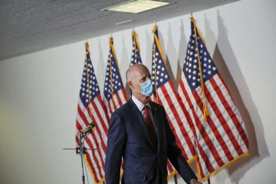 File Photo: US Senator Rick Scott (R-FL) wears a face mask during a break in a Senate Health Education Labor and Pensions Committee hearing on the coronavirus disease (COVID-19) outbreak on Capitol Hill in Washington, US, May 12, 2020. REUTERS/Carlos Barria