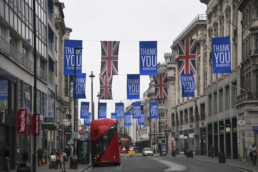 Union flags and support messages are seen in the shopping street, Oxford Street, ahead of the reopening of the non-essential businesses from Monday -AP Photo