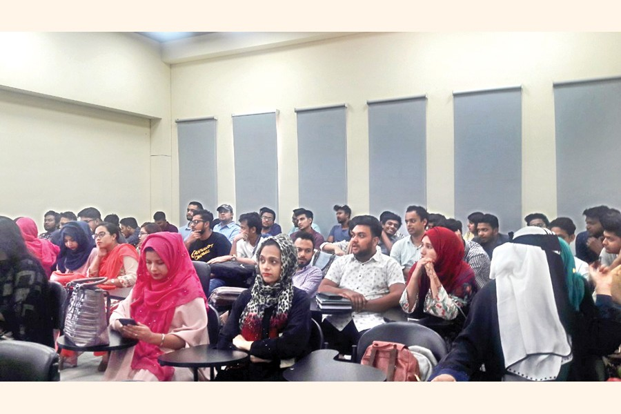 Interested candidates crowd at an ACCA admission information session