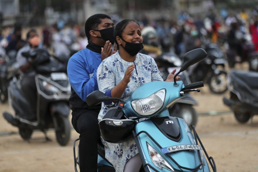 Faithful sit on their two-wheelers and pray as they attend a drive-in mass in an open area of Bethel AG Church as part of maintaining social distancing to prevent the spread of coronavirus in Bengaluru, India on Sunday, June 21, 2020 — AP photo