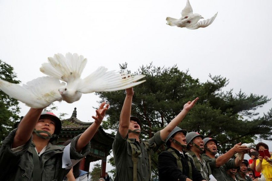 Doves are released during a ceremony commemorating the 70th anniversary of the Korean War, near the demilitarised zone separating the two Koreas, in Cheorwon, South Korea, June 25, 2020. REUTERS/Kim Hong-Ji