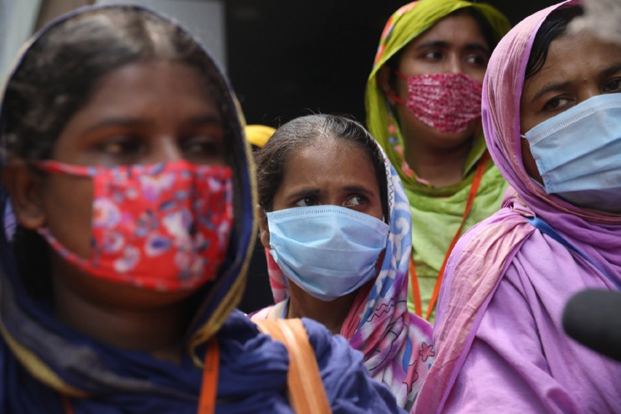 Workers of a garment factory stage demonstrations in city's Bijay Nagar area, demanding unpaid wages and withdrawal of termination — File photo