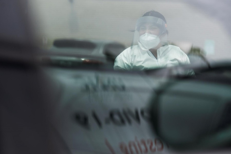 A medical worker coordinates testing as dozens of people wait in their cars at United Memorial Medical Center amid the global outbreak of the coronavirus disease (Covid-19), in Houston, Texas on US, on June 23, 2020 — Reuters photo