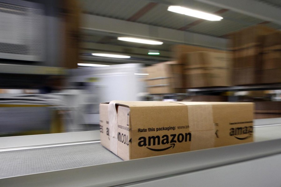 A parcel moves on the conveyor belt at Amazon's logistics centre in Graben near Augsburg on December 16, 2013 — Reuters/Files