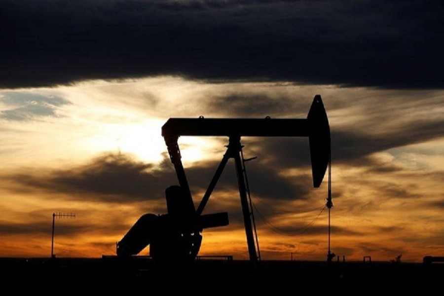 The sun sets behind a crude oil pump jack on a drill pad in the Permian Basin in Loving County, Texas, US, November 24, 2019 – Reuters/Files