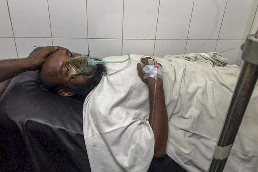 Sumon Bepari, 35, was admitted to Mitford Hospital in Dhaka when rescuers found him inside a launch 13 hours after it capsized on the Buriganga river in the capital - Collected/ bdnews24.com