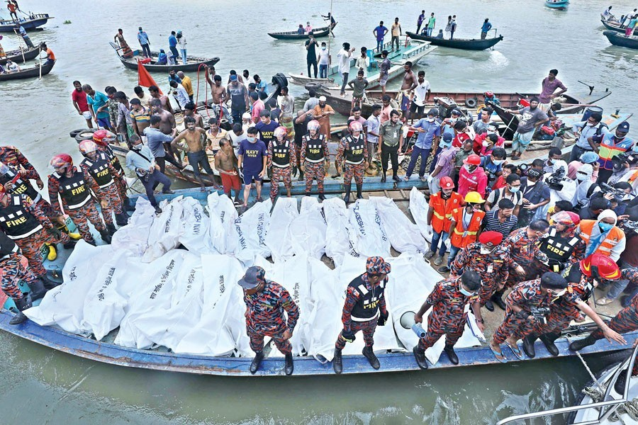 Bodies recovered by rescuers lying lined up after a launch sank in the Buriganga River at Dhaka's Shyambazar following a collision with another vessel on Monday — FE photo