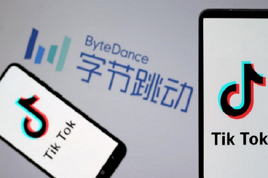 TikTok logos are seen on smartphones in front of a displayed ByteDance logo in this illustration taken November 27, 2019 – Reuters/Files