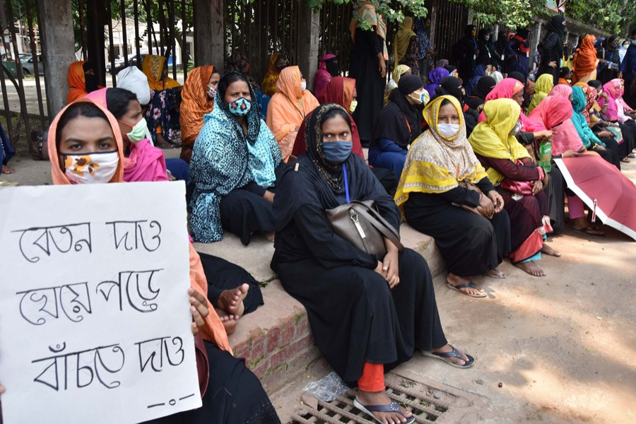 Workers of Dhaka Export Processing Zone garment factory A-One BD Ltd protest in front of National Press Club in Dhaka demanding due wages — File photo
